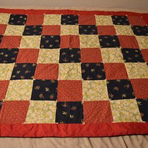 Hand-made quilt red and blue